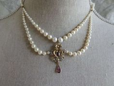 Pearl Draped Necklace with Amethyst Centerpiece | From a unique collection of vintage beaded necklaces at https://www.1stdibs.com/jewelry/necklaces/beaded-necklaces/