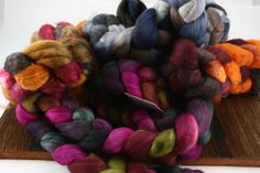 "3 boxes of Sweet Georgia Yarns and Fibers on Tuesday 12/17. New colors: ""Tea Party,"" ""Chai Spice,"" ""Phoenix Rising,"" ""Storm Chaser,"" ""Ultraviolet"" (a DARK purple tonal). Ooooh, pretty!!"