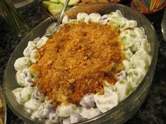 Grape Salad With a Twist.   Had this at a party last night. But the butter finger wasn't as chopped up (Which was really yummy) It looked really weird and no one wanted to taste it. BUT it was seriously SOOOO amazing. Going to make this for sure!! So happy I found it!!!!!!!