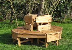 http://www.rusticgardenfurniture.com/images/bench-sets/treeseat.jpg