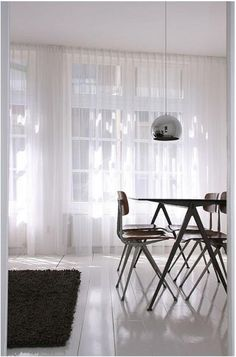 like the floor to ceiling sheer white curtains that diffuse harsh light
