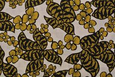 Vintage 1940s crepe fabric in unused cotton with larger printed black/ mustard yellow flower pattern on bone white bottomcolor. $10.00, via Etsy.