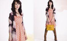 Pink polka dot dress, asymmetrical neutral striped cardigan. Mustard purse and tan boots killin' it!