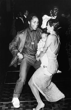 Debbie Allen and Gene Anthony Ray and her baby daughter Vivian Nicole during the 1986 reception in New York for the broadway musical, Sweet Charity. via AP Images.