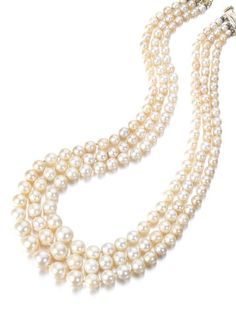 A three-row pearl necklace