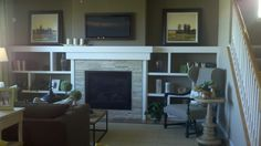 shelves around fireplace | Love the shelves around this fireplace! | FIREPLACE