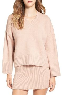 A fuzzy V-neck sweater is boxy, oversized perfection complete with slouchy dropped shoulders and dramatically wide ribbing at the cuffs and hem. Lucca Couture Oversize V-Neck Sweater