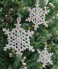 Beautiful Lacy Snowflake Ornaments - free crochet pattern by Kathryn White for Red Heart. Crochet Christmas Garland, Christmas Crochet Patterns, Crochet Ornaments, Holiday Crochet, Ornament Crafts, Snowflake Ornaments, Christmas Snowflakes, Christmas Crafts, Christmas Decorations