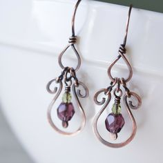 Small and lightweight stylized horseshoe drop earrings, hammered copper and purple glass beads