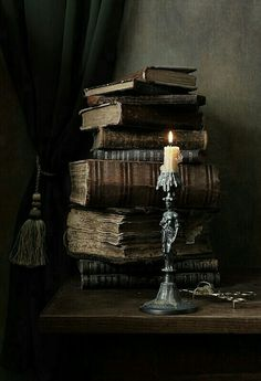 Crusty old books and candlestick. Now that's my idea of a Halloween prop   彡