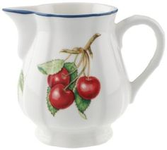 Villeroy & Boch Cottage Creamer. Traditional, but updated, the Cottage Collection embraces Americana with a new passion. The colorful red and blue berries along with soft green leaves are mixed with subtle red and blue plaids to make this pattern a new collectible.  Add a stenciled rim around dinners and salads and you have a true Americana feel .  The porcelain dinnerware is accessorized by accessories such as canisters, jam jars and etched handpainteed glassware, drinkware and giftware.