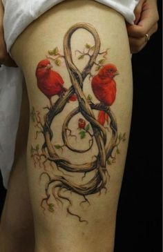 Small red birds tattoos on leg. This is beautiful