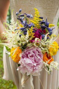 {Beautiful Wedding Bouquet Arranged With: Pink Peony, Magenta Peony, Large, Yellow Ranunculus, Orange Ranunculus, White Astilbe, Yellow Cassia, & Blue Delphinium}