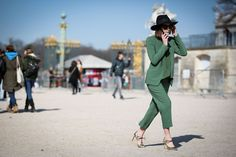84 Outfit Ideas For Style Extroverts #refinery29  http://www.refinery29.com/2015/03/83675/paris-fashion-week-2015-street-style#slide-11  Wear your silky suit with your party heels for a Studio 54-inspired look.