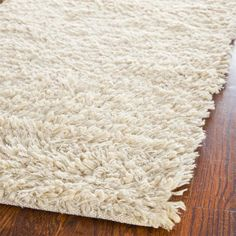 Hand-tufted white shag rug.   Product: RugConstruction Material: PolyesterColor: WhiteFe...