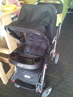 Joovy Caboose Stroller | Strolling around with two children has never been easier with this versatile Caboose Stand-On Tandem Stroller allows an older child to stand or sit down while the child rides comfortably in front. Click the link below for more details about this item. | LilyPads - Lincoln , NE