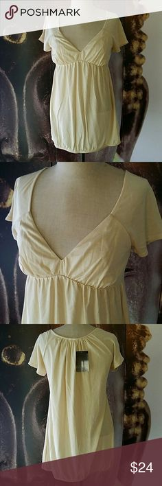 UO Kimchi Blue Pale Yellow Top NWT Nwt Kimchi Blue Top  Soft stretchy cotton material  Size medium Urban Outfitters Tops Blouses