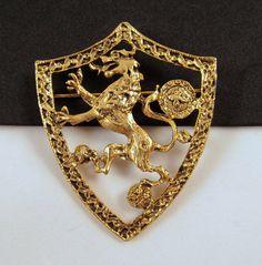 Heraldic Shield Brooch Goldtone Mythical by GrapenutGlitzJewelry, $30.00