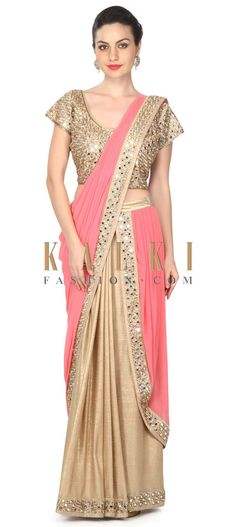 Buy this Gold and pink saree lehenga embellished in mirror work only on Kalki
