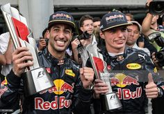 Red Bull Racings Australian driver Daniel Ricciardo (L) and his teammate Max Verstappen (R) celebrate with their trophies after the Formula One Malaysian Grand Prix in Sepang on October 2, 2016. / AFP / MOHD