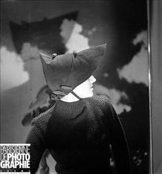 "sharp Skullcap with peak Suzanne Talbot in woollen garment surpiqué. Photographed for the magazine "" Fémina "". Paris, July, 1936."