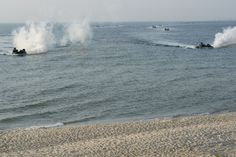 160726-N-XT273-350 ODESSA, Ukraine (July 27, 2016) U.S. Marines assigned to the 22nd Marine Expeditionary Unit conduct an amphibious landing demonstration during Sea Breeze 2016 in Odessa, Ukraine July 27. Sea Breeze is an air, land and maritime exercise designed to improve maritime safety, security and stability in the Black Sea. (U.S. Navy photo by Mass Communication Specialist 1st Class Justin Stumberg/Released)
