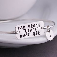 My Story Isn't Over Yet Bracelet - Silver. I desperately want this.