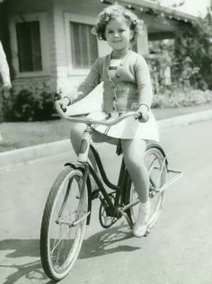 Shirley Temple riding her bicycle,1936.