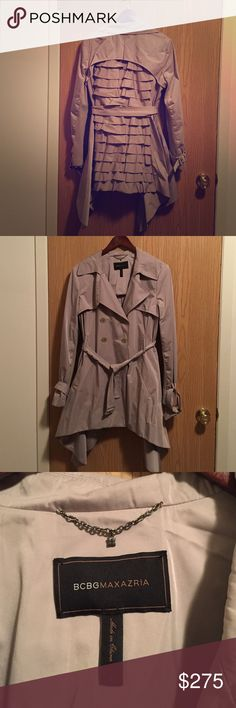 Very popular BCBGMAXAZRIA ruffle back trench coat This popular BCBGMAXAZRIA trench sold out extremely fast when it first launched. Beautiful ruffle detail on back. Handkerchief style at the bottom. Double breasted. Belted w/2 front pockets. Size Large. Actual color is light khaki. There is one teeny tiny spot on the front that will come out with dry cleaning. BCBGMaxAzria Jackets & Coats Trench Coats