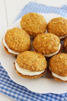 Soft, cinnamon-spiced carrot cake sandwich cookies with an easy cream cheese frosting are on the Carrot Cake Sandwich Cookies, Carrot Spice Cake, Frosting Recipes, Cookie Recipes, Dessert Recipes, Baking Recipes, Just Desserts, Delicious Desserts, Yummy Food