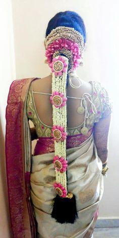 Traditional Southern Indian bride's bridal braid hair. Hairstyle by Swank Studio. #SilkSaree #Blouse #Design #HairAccessory Temple jewelry. Jhumkis. Silk kanchipuram sari. Braid with fresh flowers. Tamil bride. Telugu bride. Kannada bride. Hindu bride. Malayalee bride. Find us at https://www.facebook.com/SwankStudioBangalore