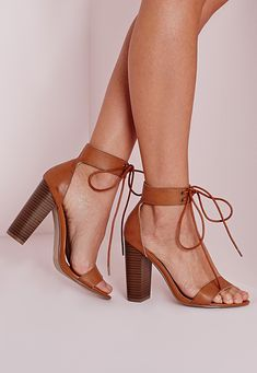 For a chunky alternative to those skimpy barley there heels, these block beauts are just what the doctor ordered. In tan faux leather, these feature a lace up strap across the ankle and a big retro block heel. Wear with a mini skirt and cro...