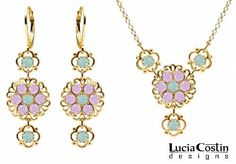 Expressive Necklace and Earrings Flower Set Designed by Lucia Costin Crafted in 14K Yellow Gold Plated over .925 Sterling Silver with Mint Blue, Lilac Swarovski Crystals and Lace Elements Lucia Costin. $124.00. Handmade in USA unique jewelry set. Floral set of jewelry by Lucia Costin. Floral design accompanied by cute details. Embellished with light - blue and light purple Swarovski crystals. Style takes wings in this lovely jewelry set that have a graceful flo...