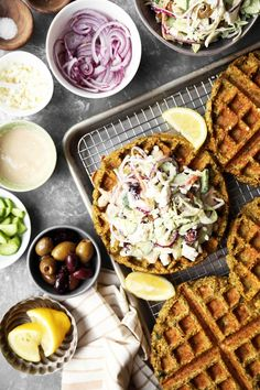 Falafel Waffles with a Mediterranean Slaw are easy to make and packed with so much flavor! Homemade falafel batter cooked in a waffle iron for added crunch!