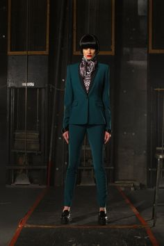 Keeping the look slim throughout (particularly in the shoulders), Stefani and co. focused on tailoring in the form of novelty suits in shiny satin or a vibrant camouflage jacquard. Military remains a perennial influence at L.A.M.B.