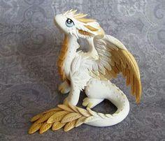 An adorable little White/Gold Dragon.....