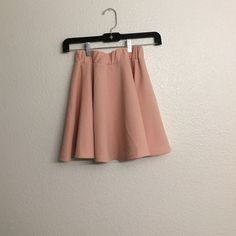 Light pink skater skirt Size S/M, I bought it from Amazon. Very nice material, has elastic waistband and is not too short in length. Goes very well with a white crop top. The skirt can be worn high waisted or low since the length is decent. I will model if asked  Skirts Midi