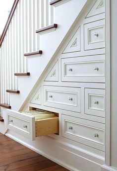 This overlooked part of the house has tons of pack-it-in potential. storage tips and organization tricks for small space living. under the stairs storage. how to maximize the space under stairs. Under Stairs Storage Drawers, Stair Storage, Stair Drawers, Staircase Storage, Wall Storage, Eaves Storage, Wooden Drawers, Staircase Ideas, Basement Storage