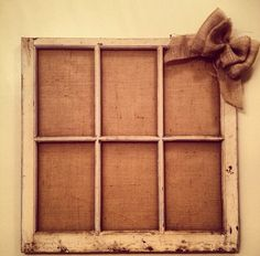 Old window pane with burlap background. @Susan Hunter Mills  what do you think of this idea with black and white pictures in every other slot :) but the pictures smaller so you can see the burlap :)