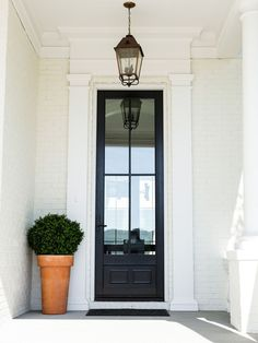 Black front door paint color Benjamin Moore 2122-20 Steep Cliff Gray #BenjaminMooreSteepCliffGray Ramage Company