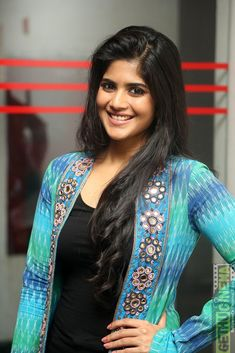 Megha Akash Stills at LIE Movie Success Meet. Kollywood actress Megha Akash attended the success meet of her movie LIE wearing black denims and a black tank top paired with a mirror embroidered ikat print long jacket. Indian Film Actress, South Indian Actress, Indian Actresses, South Actress, Beautiful Girl Indian, Beautiful Indian Actress, Beautiful Women, Arjun Sarja, Megha Akash