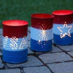 Repurposed Can Luminaries (4th of July) -- I'm thinking of instead of a 4th of July theme, an airplane theme.  Invert the cans and put twinkle lights inside and making patio lights. July 4th decor #PartyIdeas