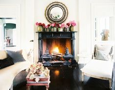 amazing fireplace and mantle full of flowers
