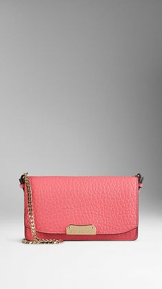 Rose Pink Small Signature Grain Leather Clutch Bag with Chain from Burberry.  Structured clutch bag in signature grain leather.  Detachable polished metal chain shoulder strap, foldover front, hand-painted edges.  Clip lock closure and interior zip compartment.  Discover the women's bags collection at Burberry.com