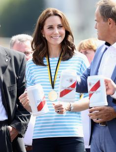 Catherine, Duchess of Cambridge holds a beer after participating in a rowing race between the twinned town of Cambridge and Heidelberg during an official visit to Poland and Germany on July 20, 2017 in Heidelberg, Germany.