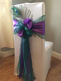 Peacock themed wedding chair cover designed by affinity event decorators in South Wales Www.Affinityeventdecorators.Com More