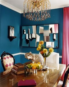 """Loving the teal walls, """"broken"""" mirror, chandelier, high gloss table and of course, the elephant. Would have to change the curtains from pink to either  Hermes orange or blood red."""