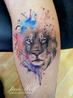 Realistic lion face with colored ink splatter effect around it. Looks phenomenal.