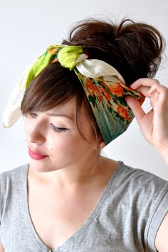 Tutorial on how to tie a head scarf.  I don't know when I'll ever wear this, but it does add a little 'umpf' if your hair is up.