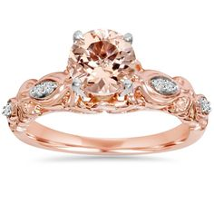 Women's ring features a 7mm round morganite and 8 round cut diamonds set in solid 14k rose gold.